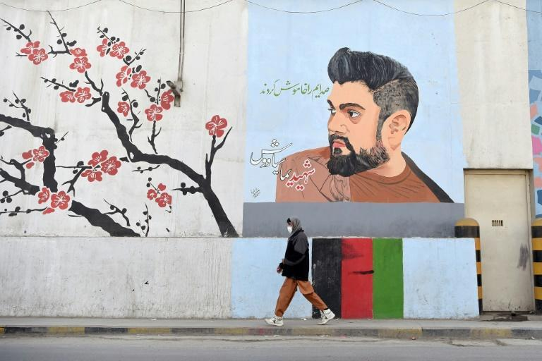 A roadside mural in Kabul pays homage to former Afghan Tolo TV presenter Yama Siawash, who was killed in a bomb attack on November 7, 2020