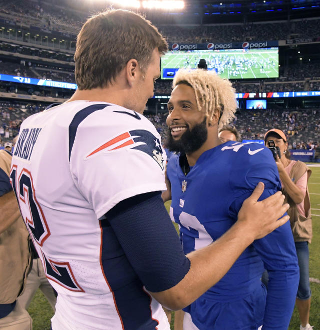 New England Patriots quarterback Tom Brady (12) talks with New York Giants wide receiver Odell Beckham (13) at the end of an NFL preseason football game, Thursday, Aug. 30, 2018, in East Rutherford. The Patriots won 17-12. (AP Photo/Bill Kostroun)