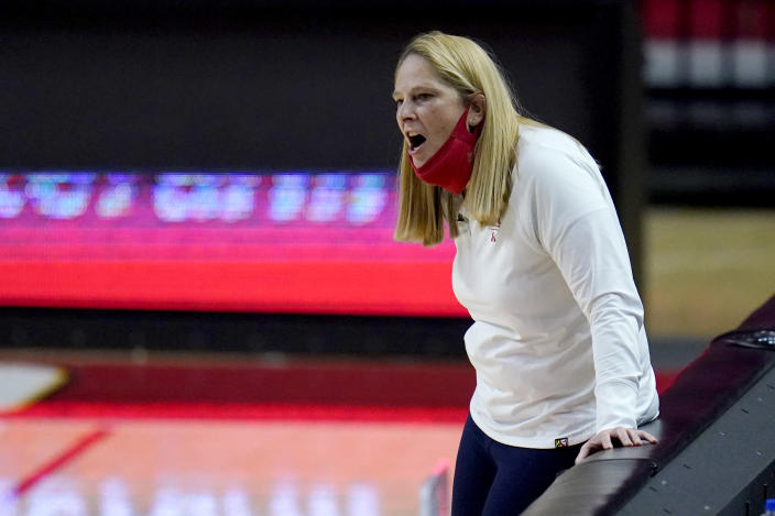 Maryland head coach Brenda Frese reacts during the second half of an NCAA college basketball game against Wisconsin, Thursday, Feb. 4, 2021, in College Park, Md. Frese tied a school record with her 499th win, reaching the milestone by guiding the 10th-ranked Terrapins past Wisconsin 84-48. Frese matched the mark set by Hall of Fame coach Chris Weller, who was at Maryland from 1975-2002. Weller was replaced by Frese, who's 499-130 over 19 seasons. (AP Photo/Julio Cortez)