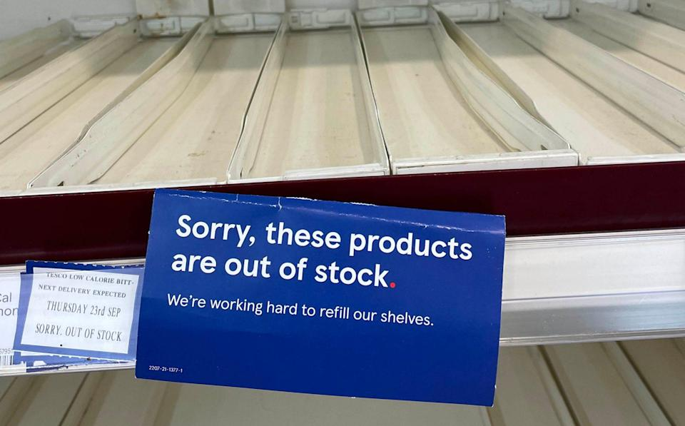 Empty shelves in the drinks section of a branch of Tesco in Liverpool - PA