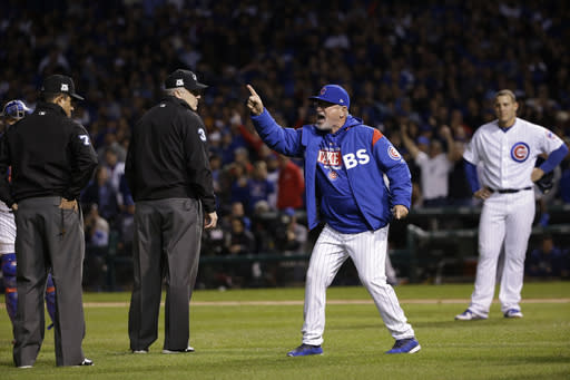 Chicago Cubs manager Joe Maddon argues with umpires during the eighth inning of Game 4 of baseball's National League Championship Series against the Los Angeles Dodgers, Wednesday, Oct. 18, 2017, in Chicago. Maddon was ejected from the game. (AP Photo/Nam Y. Huh)