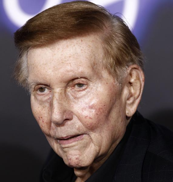 FILE - This Oct. 14, 2011 file photo shows Sumner Redstone in Los Angeles. George Washington University is getting $80 million to address public health challenges from philanthropic groups connected to Michael Milken and Sumner Redstone. The gifts include $40 million from the Milken Institute to support research and scholarships and $30 million from the Sumner M. Redstone Charitable Foundation to help expand wellness and disease prevention. A $10 million gift from the Milken Family Foundation will support, in part, a new public health scholarship program. The university is renaming its public health school as the Milken Institute School of Public Health for the 1980s junk bond king. (AP Photo/Matt Sayles, File)