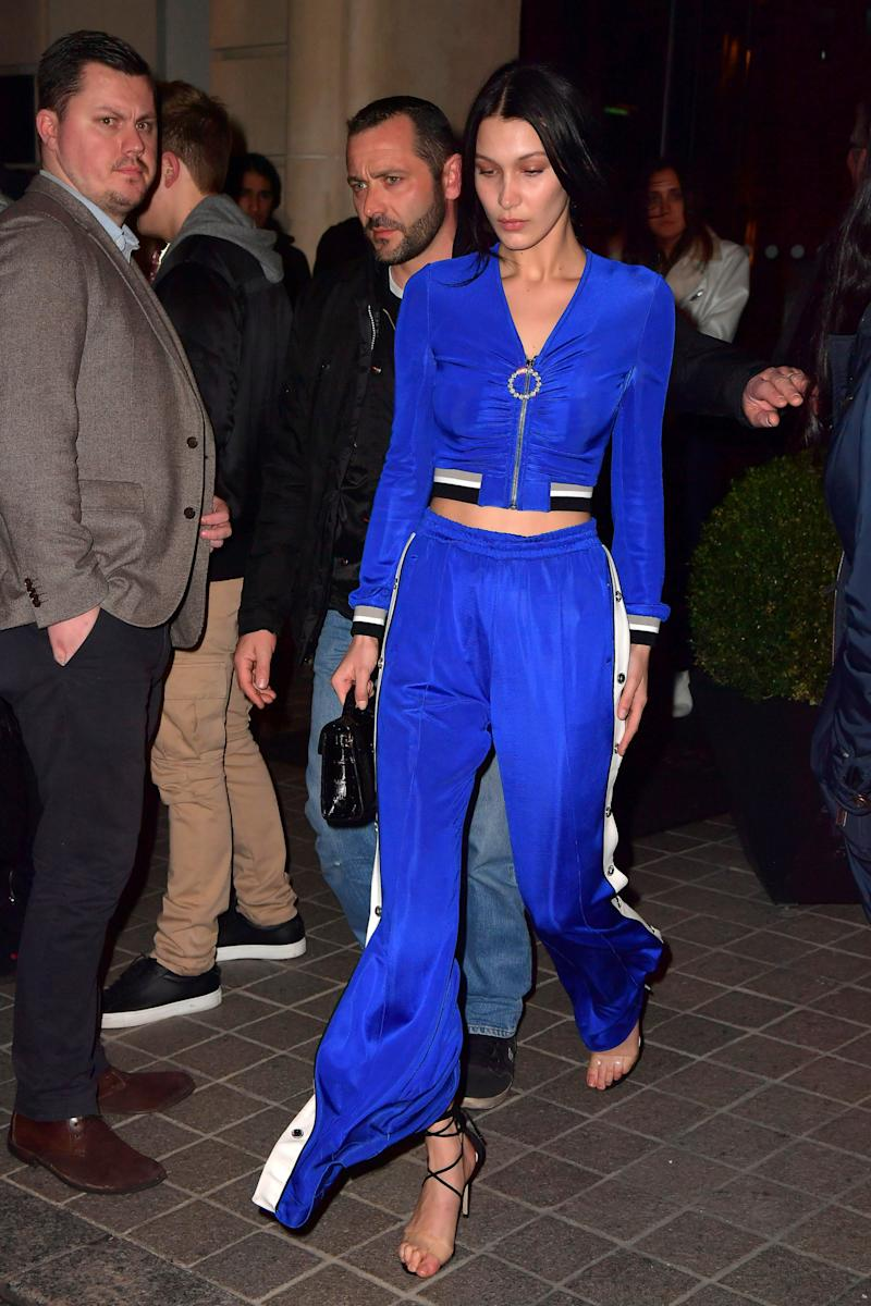 Bella Hadid paired strappy stilettos with a tracksuit at Paris Fashion Week in March. While her coordinates were not quite PJs, the same principles apply.  (Splash News)