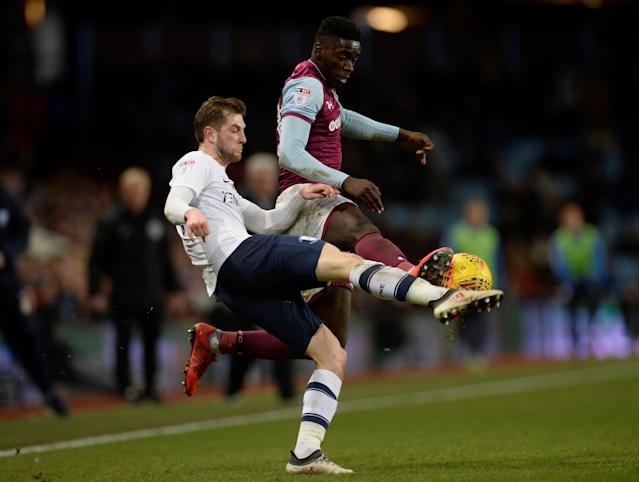 "Soccer Football - Championship - Aston Villa vs Preston North End - Villa Park, Birmingham, Britain - February 20, 2018 Aston Villa's Axel Tuanzebe in action with Preston North End's Tom Barkhuizen Action Images/Adam Holt EDITORIAL USE ONLY. No use with unauthorized audio, video, data, fixture lists, club/league logos or ""live"" services. Online in-match use limited to 75 images, no video emulation. No use in betting, games or single club/league/player publications. Please contact your account representative for further details."