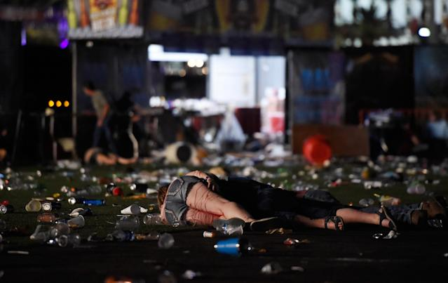 <p>A person lies on the ground covered with blood at the Route 91 Harvest country music festival after apparent gun fire was heard on Oct. 1, 2017 in Las Vegas, Nevada. There are reports of an active shooter around the Mandalay Bay Resort and Casino. (Photo: David Becker/Getty Images) </p>