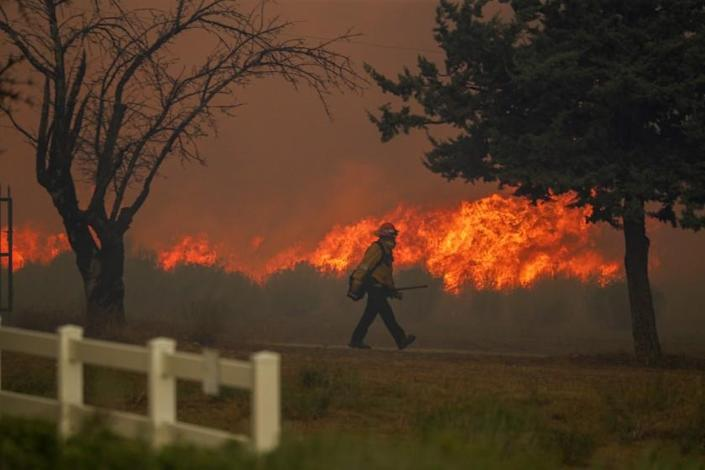 """A structure protection crew works on Cima Mesa Road in Little Rock, Calif., on Sept. 18 as the Bobcat fire jumps the road, threatening more structures. <span class=""""copyright"""">(Los Angeles Times)</span>"""