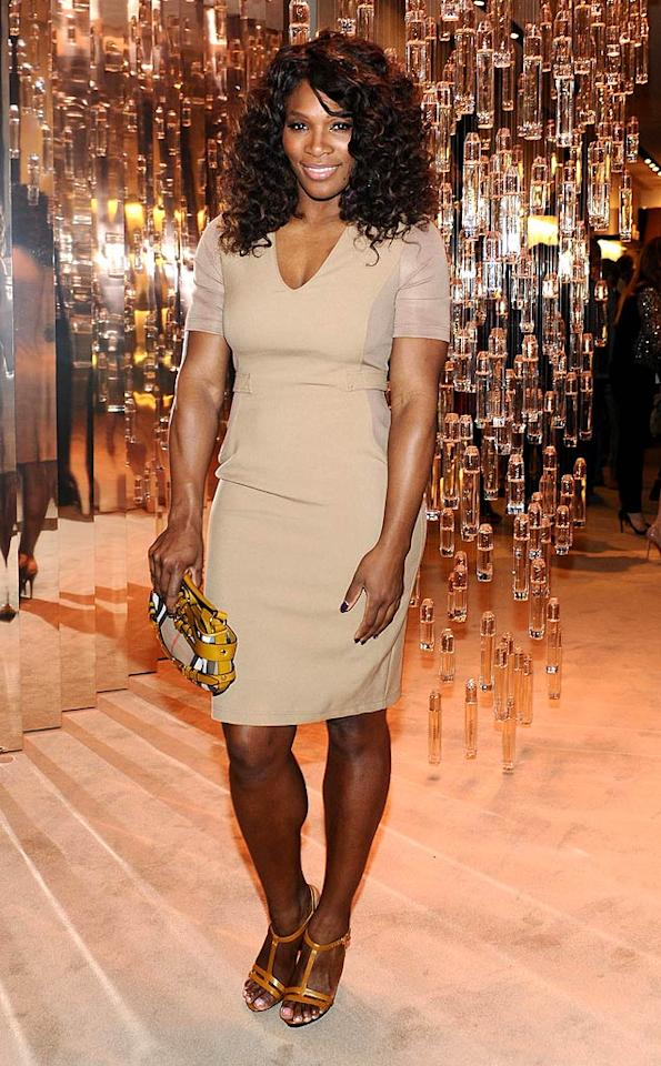 Inside, pro tennis player Serena Williams looked a bit drab in her beige V-neck dress ... but at least she had her colorful Burberry purse!   (10/26/2011)
