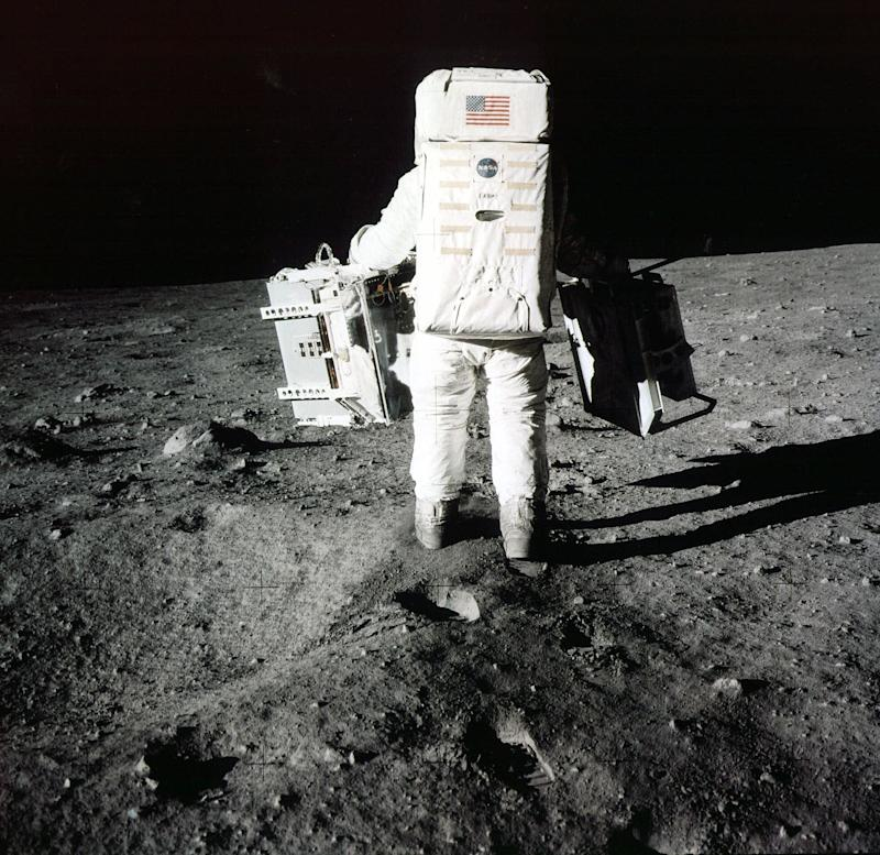 Buzz Aldrin carries scientific experiments to a deployment site south of the lunar module Eagle, July 20, 1969. Photo was taken by Neil Armstrong of the Apollo 11 mission.   Neil Armstrong/AP