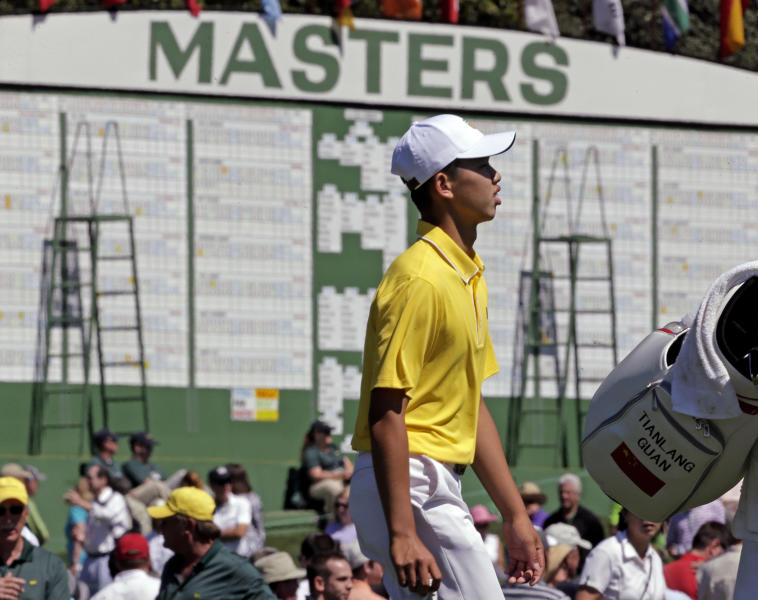 Amateur Guan Tianlang, of China, walks up the ninth fairway during the third round of the Masters golf tournament Saturday, April 13, 2013, in Augusta, Ga. (AP Photo/Charlie Riedel)