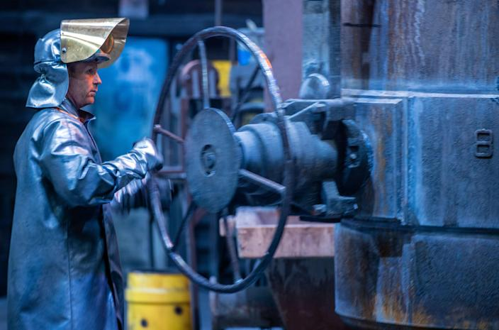 A worker prepares liquid iron for casting at the Eisengießerei Torgelow iron foundry in Mecklenburg, Western Pomerania, Germany. Photo: Jens Büttner/Picture alliance via Getty