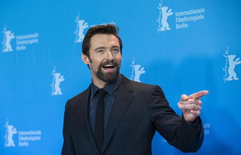 FILE - In this Saturday, Feb. 9, 2013 file photo, actor Hugh Jackman poses at the photo call of the film Les Miserables at the 63rd edition of the Berlinale, International Film Festival in Berlin. Police say 47-year-old Kathleen Thurston is charged with stalking Jackman after approaching him, crying and shouting, and throwing a razor at the Australian actor while he was working out at a gym in New York, on Saturday, April 13, 2013. (AP Photo/Gero Breloer, File)