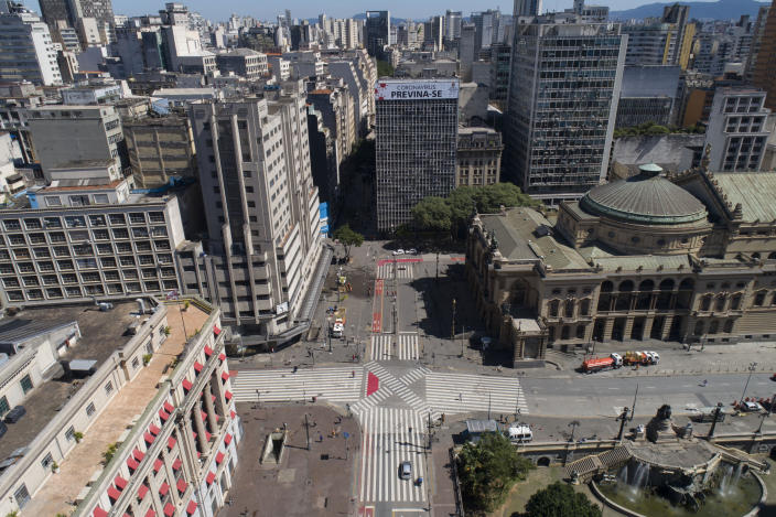 """A building is covered by the Portuguese message: """"Coronavirus: take precaution"""" over empty streets in downtown Sao Paulo, Brazil, Monday, March 23, 2020. (AP Photo/Andre Penner)"""
