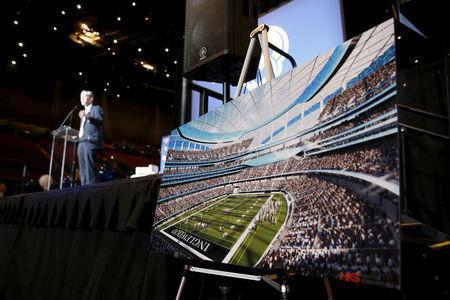 FILE PHOTO - Los Angeles Rams Chief Operating Officer Kevin Demoff speaks behind an illustration of the Rams planned new stadium at a celebration to welcome NFL team, the Los Angeles Rams, at the Forum in Inglewood, Los Angeles, California, United States, January 15, 2016. REUTERS/Lucy Nicholson/File Photo