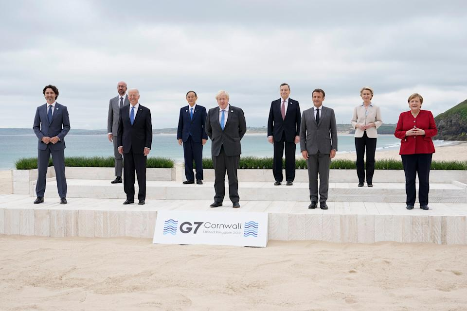 Leaders of the G7 pose for a group photo on overlooking the beach at the Carbis Bay Hotel in Carbis Bay, St. Ives, Cornwall, England, Friday, 11 June, 2021 (AP)