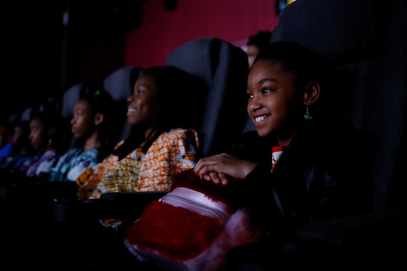 Saige Cabral, 10, joins classmates in watching the film.
