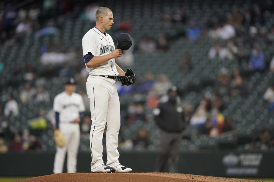 Seattle Mariners starting pitcher Chris Flexen pauses on the mound during the third inning of the team's baseball game against the San Francisco Giants, Saturday, April 3, 2021, in Seattle. (AP Photo/Ted S. Warren)