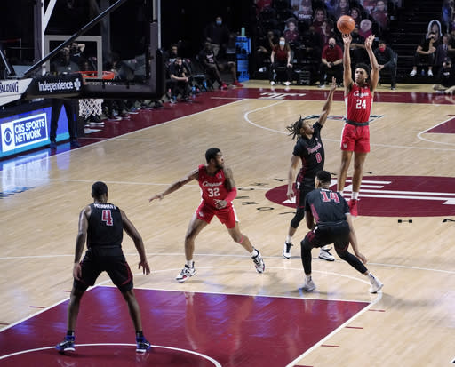 Houstons's Quentin Grimes (24) takes a jump shot over Temple's Khalif Battle (0) in the second half of an NCAA college basketball game, Saturday, Jan. 23, 2021, in Philadelphia. Houston won 68-51. (AP Photo/Michael Perez)