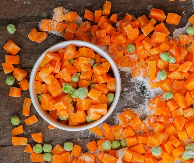<p>I typically pay $2 for 750g bags of frozen peas and carrots and throw these into rice, quinoa, and ground meat dishes.<i>[Photo: Getty]</i></p>