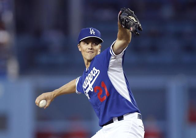 Los Angeles Dodgers starting pitcher Zack Greinke delivers to the Los Angeles Angels in the first inning of an exhibition baseball game in Los Angeles, Thursday, March 27, 2014. (AP Photo/Danny Moloshok)