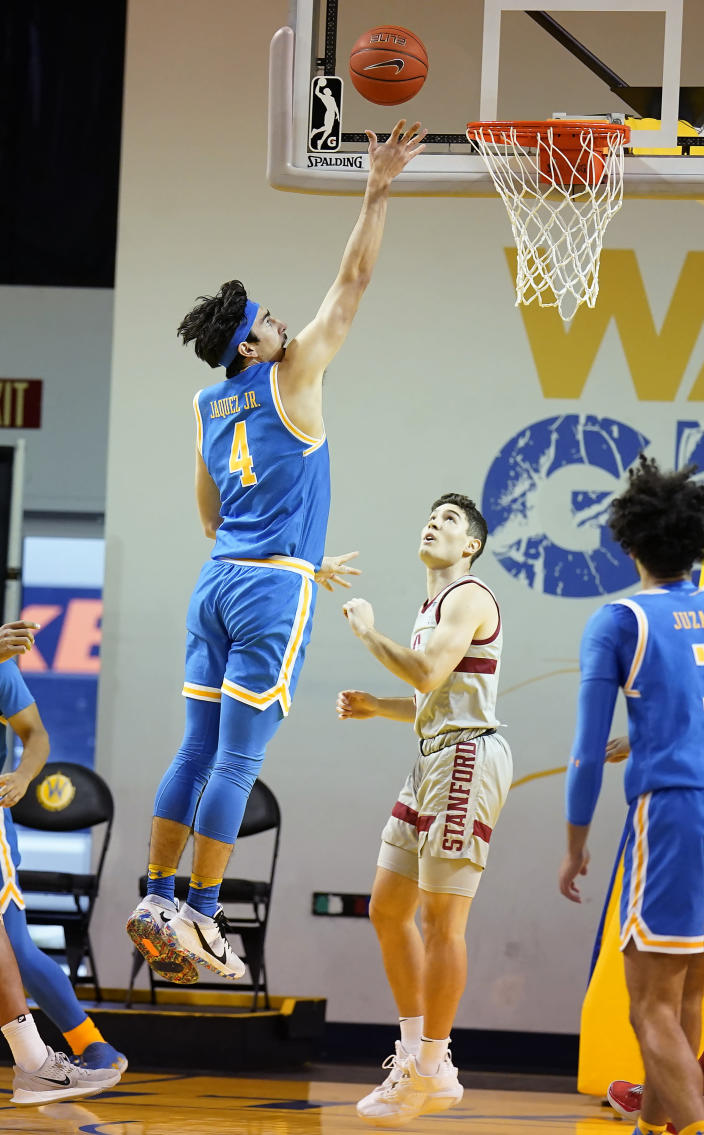 UCLA guard Jaime Jaquez Jr. (4) shoots over Stanford guard Michael O'Connell during the first half of an NCAA college basketball game in Santa Cruz, Calif., Saturday, Jan. 23, 2021. (AP Photo/Tony Avelar)