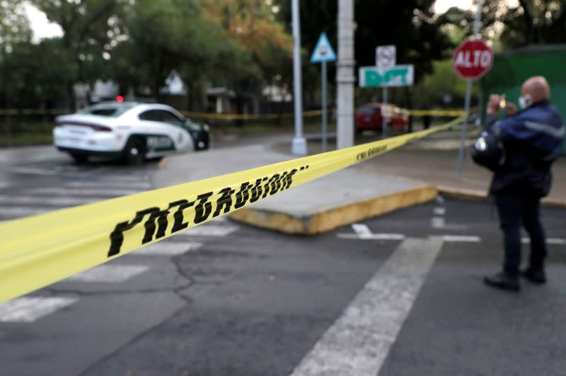 A police cordon tape is seen at an area where a shooting took place in Mexico City