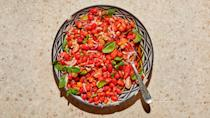 """If you're starting to get Sungolds or other small tomatoes from your backyard plants or local farmers market, this is the perfect July 4th salad recipe to celebrate them. Soaking golden raisins in cider vinegar plumps them up and adds a touch of sweetness to the vinegar in the dressing. <a href=""""https://www.epicurious.com/recipes/food/views/tomato-salad-with-pine-nuts-and-pomegranate-molasses?mbid=synd_yahoo_rss"""" rel=""""nofollow noopener"""" target=""""_blank"""" data-ylk=""""slk:See recipe."""" class=""""link rapid-noclick-resp"""">See recipe.</a>"""