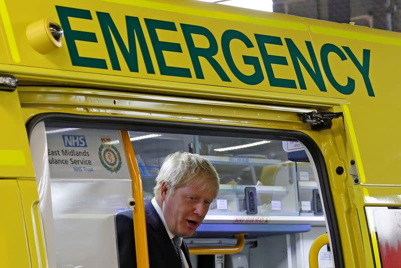 FILE PHOTO: Britain's Prime Minister Boris Johnson looks out from an ambulance during a visit to Pilgrim Hospital in Boston, Britain August 5, 2019.