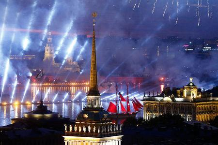 Sweden's brig Tre Kronor with scarlet sails floats on the Neva River past the Admiralty building, the Peter and Paul cathedral and the State Hermitage museum during the festivities marking school graduation in St. Petersburg, Russia June 24, 2018. REUTERS/Anton Vaganov