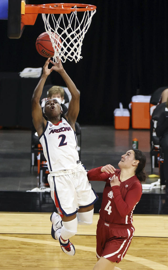 Arizona guard Aari McDonald (2) fails to catch a pass under the basket as Washington State guard Krystal Leger-Walker (4) defends during the first half of an NCAA college basketball game in the second round of the Pac-12 women's tournament Thursday, March 4, 2021, in Las Vegas. (AP Photo/Isaac Brekken)