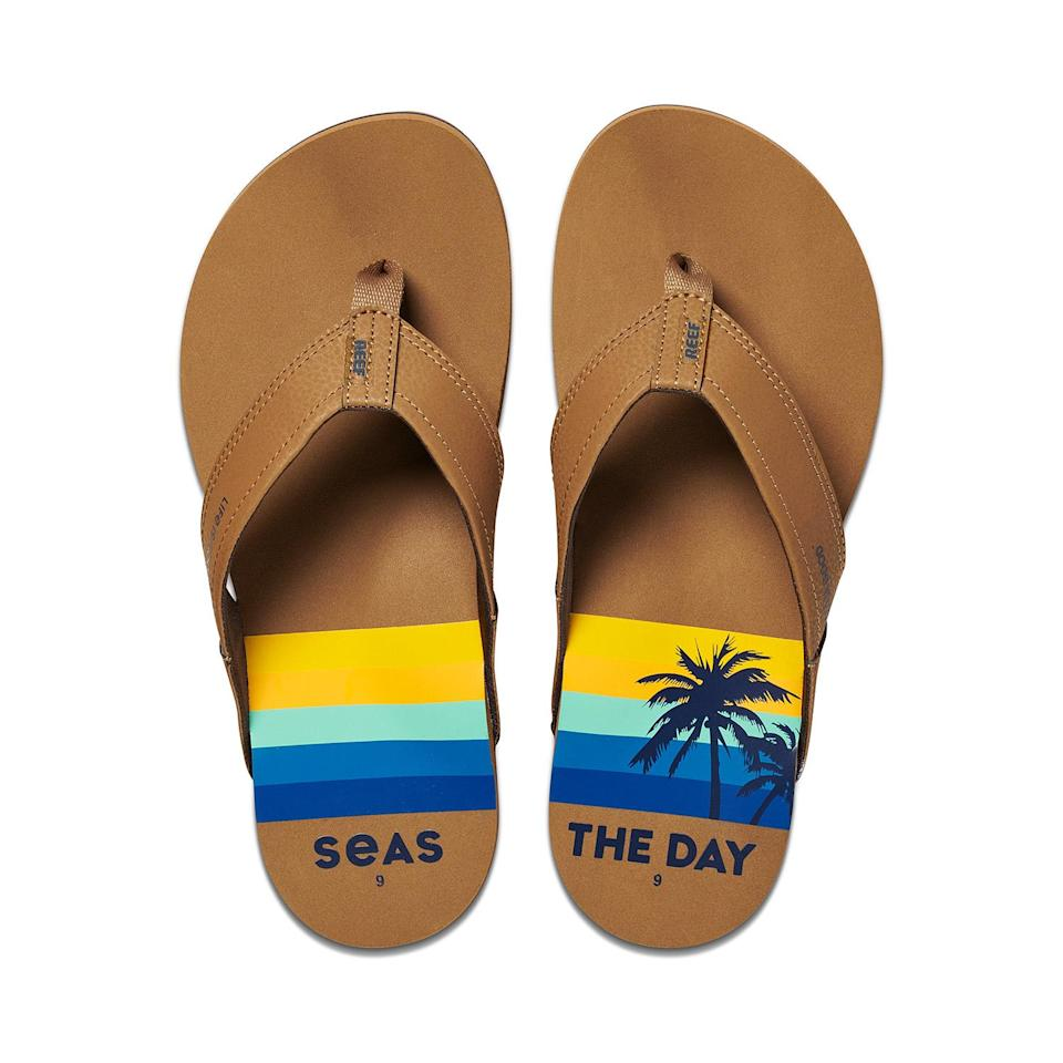 """<p>The only thing he loves more than a comfy shoe is a good dad joke? These cushy leather flip flops deliver hugely on both fronts.</p> <p><strong>Buy It! </strong>Reef x Life Is Good flip-flops, $35; <a href=""""https://www.anrdoezrs.net/links/8029122/type/dlg/sid/PEOFathersDayGiftGuide2021EditorsPicksaapatoff1271LifGal12743659202106I/https://www.lifeisgood.com/accessories/reef-sandals/mens-seas-the-day-reef-newport-flip-flops-CI4851.html?dwvar_CI4851_color=58360&cgid=accessories-reef"""" rel=""""sponsored noopener"""" target=""""_blank"""" data-ylk=""""slk:lifeisgood.com"""" class=""""link rapid-noclick-resp"""">lifeisgood.com</a></p>"""