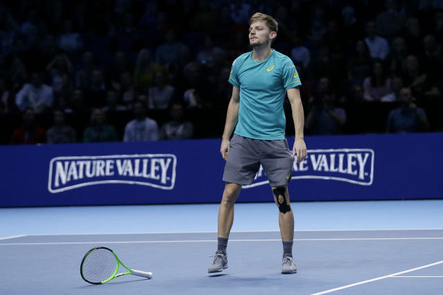 David Goffin of Belgium celebrates winning match point against Roger Federer of Switzerland during their ATP World Tour Finals semifinal tennis match at the O2 Arena in London, Saturday Nov. 18, 2017. (AP Photo/Tim Ireland)