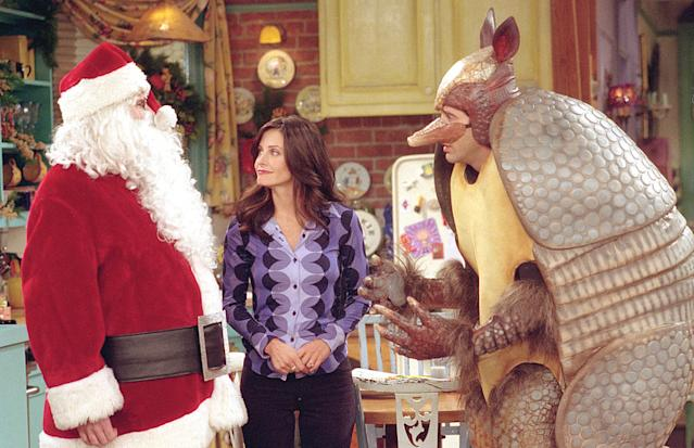 David Schwimmer, right, wears the Holiday Armadillo costume, alongside Matthew Perry and Courteney Cox on <em>Friends</em>. (Photo: Warner Bros. Television)
