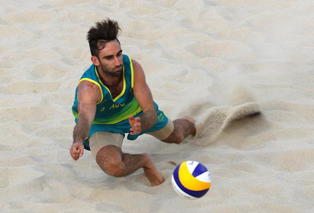 Beach Volleyball - Gold Coast 2018 Commonwealth Games - Men's Gold Medal Match - Australia v Canada - Coolangatta Beachfront - Gold Coast, Australia - April 12, 2018. Damien Schumann of Australia in action. REUTERS/Athit Perawongmetha