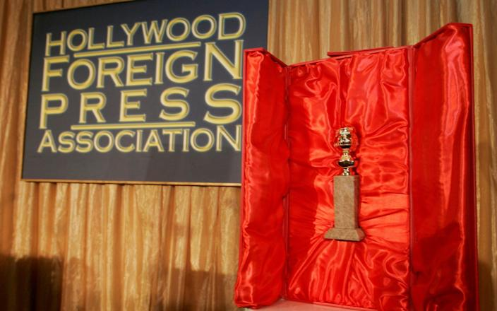 The Hollywood Foreign Press Association's Golden Globe statuette is seen with its red velvet-lined, leather-bound chest during a news conference in Beverly Hills, California - Reuters
