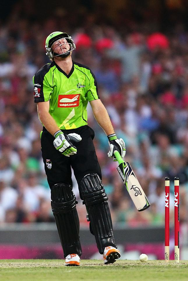 SYDNEY, AUSTRALIA - DECEMBER 08: Martin Guptill of the Thunder is bowled by Luke Feldman of the Sixers during the Big Bash League match between the Sydney Sixers and the Sydney Thunder at Sydney Cricket Ground on December 8, 2012 in Sydney, Australia.  (Photo by Mark Nolan/Getty Images)