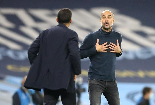 Guardiola (right) exchanged words Porto manager Sergio Conceicao during a fiery game in Manchester in October