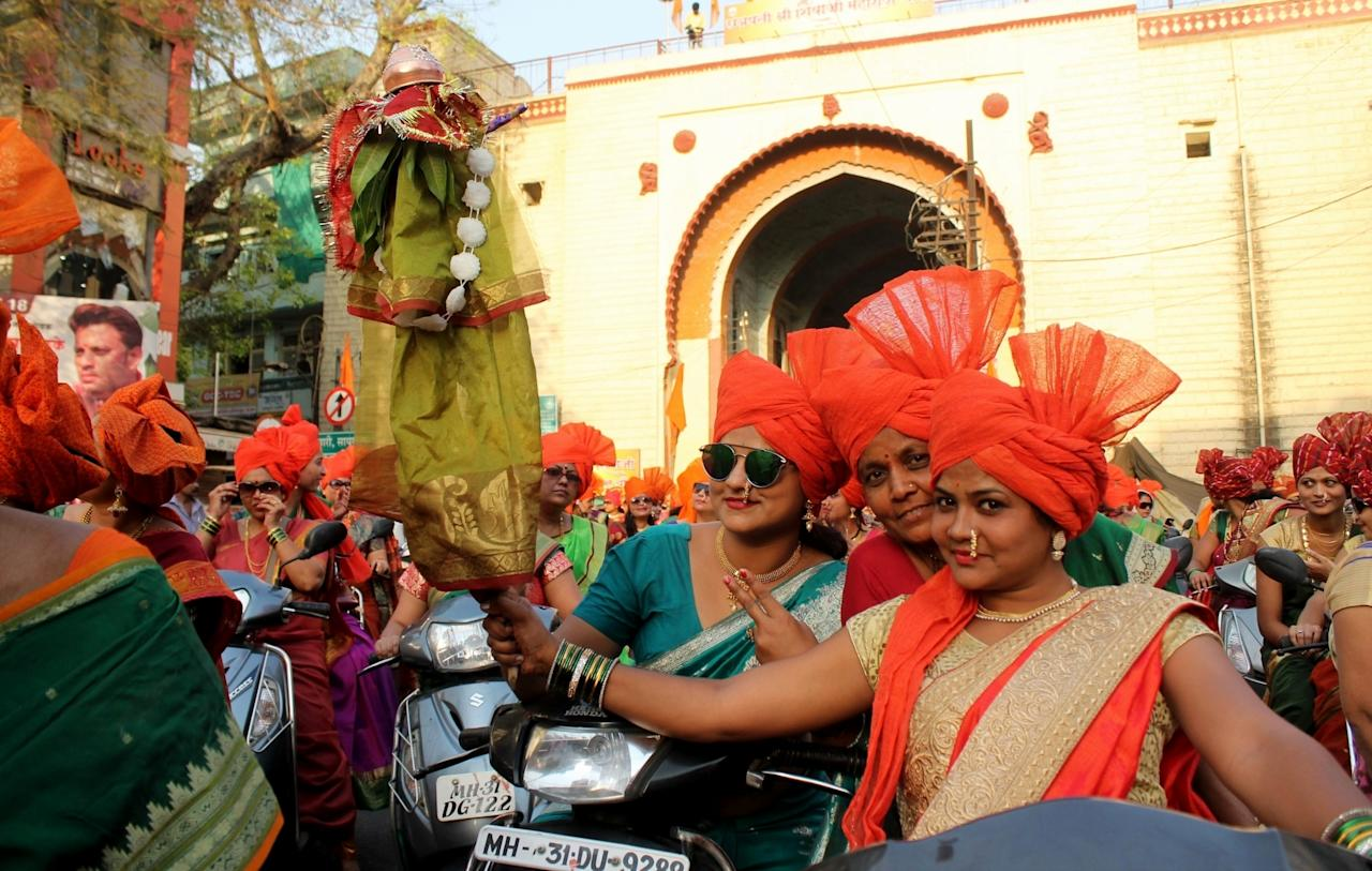<p>Women participate in a bike rally ahead of Gudi Padwa in Nagpur, on March 27, 2017. (Photo: IANS) </p>