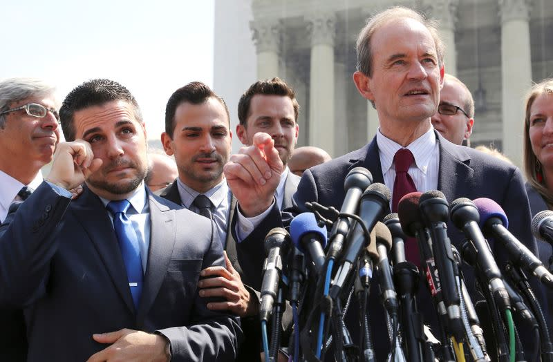 FILE PHOTO: Zarrillo wipes away his tears and Katami looks on, both plaintiffs in the case against California's gay marriage ban known as Prop 8, as attorney Boies talks to reporters outside the Supreme Court in Washington