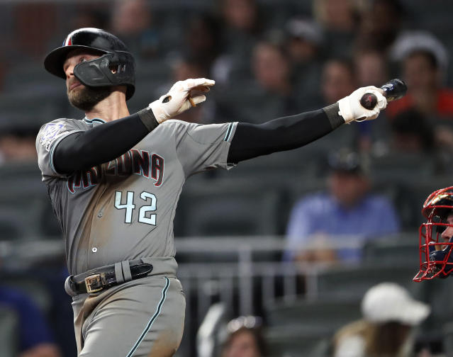 Arizona Diamondbacks' Christian Walker (53) follows through on a solo-home run in the ninth inning of a baseball game against the Atlanta Braves, Tuesday, April 16, 2019, in Atlanta. (AP Photo/John Bazemore)