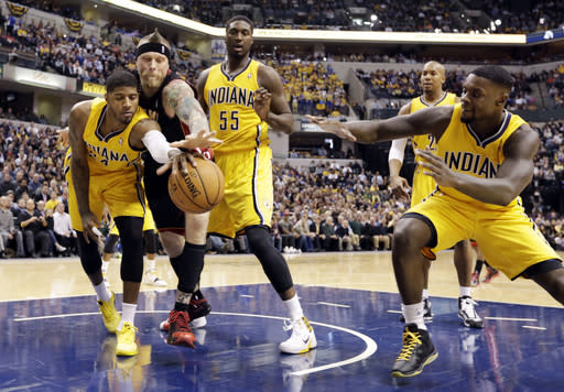 Miami Heat forward Chris Andersen, second from left, Indiana Pacers forward Paul George, left, center Roy Hibbert (55) and guard Lance Stephenson go for a loose rebound in the first half of an NBA basketball game in Indianapolis, Tuesday, Dec. 10, 2013. (AP Photo/Michael Conroy)