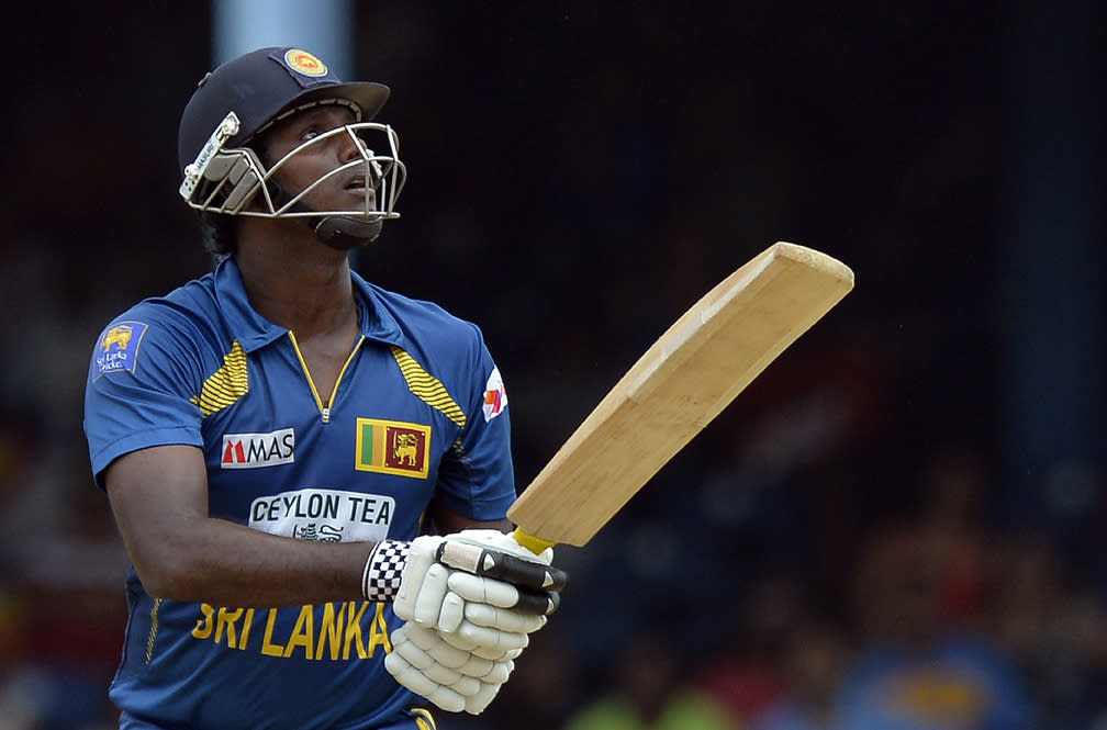 Sri Lankan cricket team captain Angelo Mathews looks on after playing a shot to be caught off Indian bowler Ishant Sharma during the final match of the Tri-Nation series between India and Sri Lanka at the Queen's Park Oval stadium in Port of Spain on July 11, 2013. India won the toss and elected to field first. AFP PHOTO/Jewel Samad