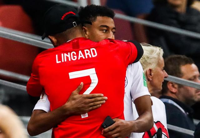 Not to be: Jesse Lingard gets a hug after the team fell to defeat