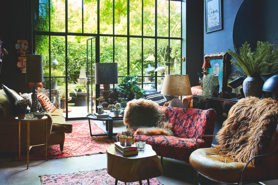 """<p>""""My main living area overlooks the garden and the Crittall windows we put in two years ago have made the space feel so much more inclusive. It was one of the best decorating decisions I've actually made. I bought the sofa from <a href=""""https://www.georgesmith.com/"""" rel=""""nofollow noopener"""" target=""""_blank"""" data-ylk=""""slk:George Smith"""" class=""""link rapid-noclick-resp"""">George Smith</a> 20 years ago and it's as comfy now as when we brought it. It's covered in a cashmere mohair blend and the colour inspired the paint colour on the kitchen cabinetry – a burnt toffee.""""</p>"""