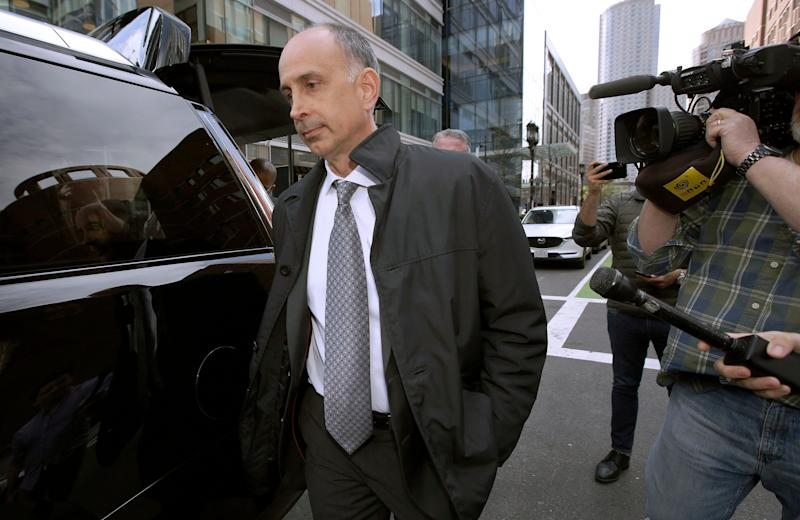 California businessman Stephen Semprevivo departs federal court Tuesday, May 7, 2019, in Boston, after pleading guilty to charges that he bribed the Georgetown tennis coach to get his son admitted to the school. (AP Photo/Steven Senne) ORG XMIT: NYOTK