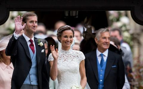 David Matthews, right, on the wedding day of his son James and Pippa Middleton. He is understood to deny the allegations - Credit: UK Press Pool/Getty Images