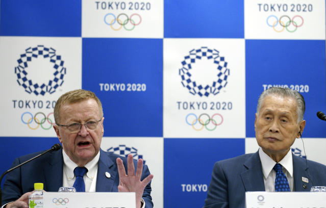 John Coates, left, chairman of the IOC Coordination Commission for the 2020 Tokyo Olympics and Paralympics and Tokyo Olympic organizing committee President Yoshiro Mori attend the IOC and Tokyo 2020 joint press conference Wednesday, Sept. 12, 2018. (AP Photo/Eugene Hoshiko)