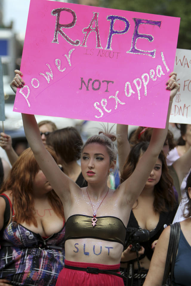 Elli Rego holds up a sign while participating in the Slut Walk demonstration in Philadelphia, on Saturday, Aug. 6, 2011. Organizers of the walk aim to raise awareness for women's issues including the fact that no woman asks to be raped because of her style of dress. (AP Photo/ Joseph Kaczmarek)