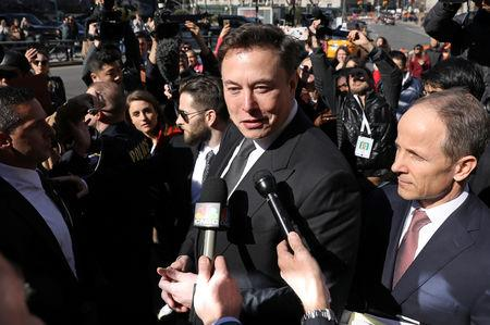 FILE PHOTO: Tesla CEO Elon Musk speaks at Manhattan federal court after a hearing on his fraud settlement with the SEC in New York