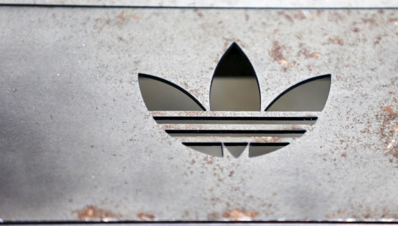 The Adidas logo on an iron bench is pictured at the flagship store in Berlin