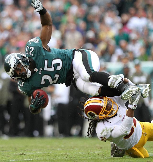 Philadelphia Eagles running back LeSean McCoy (25) is upended by Washington Redskins safety Brandon Meriweather during a second-quarter run during an NFL football game in Philadelphia, Sunday, Nov. 17, 2013. (AP Photo/The News-Journal, Andre L. Smith)